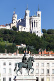 Statue of Louis XIV and Basilique Fourviere Stock Photo