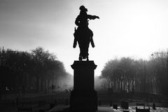 Statue in frond of Versailles Castle. Statue of Louis XIV in front of the palace of Versailles, France Stock Photography