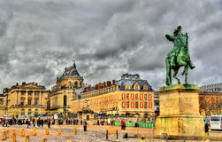 Statue of Louis XIV in front of the Palace of Versailles Royalty Free Stock Images