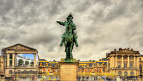 Statue of Louis XIV in front of the Palace of Versailles Royalty Free Stock Photo