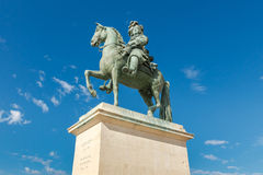 Statue of Louis XIV in front of versailles palace, France Stock Image