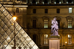 Statue at Louvre courtyard in Paris Royalty Free Stock Image