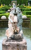 Statue of lovely boy and girl in the public garden Stock Photography