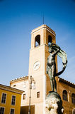 Statue of luck and bell tower Royalty Free Stock Photo