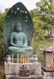 Statue méditante verte de Bouddha au temple bouddhiste de Kurodani Photo libre de droits