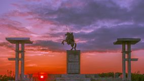 The statue of Ma yuan in the sunset. Ma yuan was a famous military general in the han dynasty. His deeds were respected by later generations Stock Images