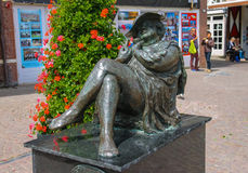 Statue of Madam Migraine by Rene Rikkelman in Zandvoort Royalty Free Stock Photo