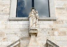 Statue Maddon and Child on the facade of the church of Santa Maria della Stella, Ostunia Royalty Free Stock Image