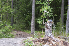Statue made of old pine tree stump Royalty Free Stock Photos