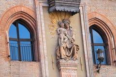 Statue of the Madonna in Bologna. Italy. Statue of the Madonna (Niccolo del Arca) on the facade Palazzo Comunale in Bologna. Italy Stock Photos