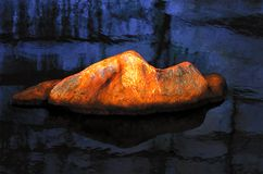 Statue of magma sleeps. Above the water bed Royalty Free Stock Images