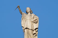 Statue of a male guardian with  dagger in his hands Royalty Free Stock Photos