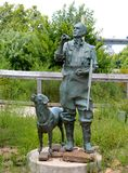 Statue of Man and Bird Hunting Dog. Steel Statue of Man in field and stream gear with Bird hunting dog royalty free stock photo