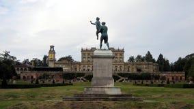 Statue of a man carrying a woman in a garden, England Stock Photos
