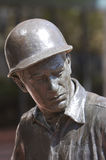 Statue on Man with Hard Hat Stock Image