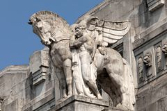 Statue of a man holding a winged horse on the Milan's main railway station Royalty Free Stock Images