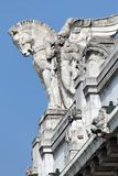 Statue of a man holding a winged horse on the Milan's main railway station Stock Photography
