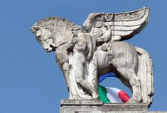 Statue of a man holding a winged horse on the Milan's main railway station Royalty Free Stock Image