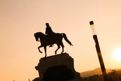 Statue of a man on a horse in dynamic composition, sunset and co stock photos