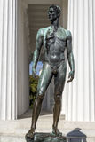 Statue of a Man. A Statue placed in front of a monument in Vienna, Austria Royalty Free Stock Photos