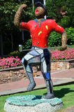 Statue of Man playing golf. In Charlotte Stock Image