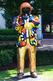 Statue of man playing horn. In Charlotte Stock Photo