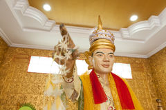 Statue man pointing the way in Myanmar Stock Photo