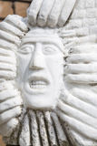 Statue of man's face with gritted teeth Royalty Free Stock Image