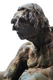 Statue of a man. Sculpture of a strange man made in stone Royalty Free Stock Images