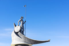 Statue of man with spear in boat Stock Images
