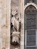 Statue of man in toga of Cathedral of Milan. Statue of a man in a toga and a helmet decorating the side wall of a Cathedral of Milan, Italy Stock Photos