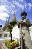 Statue of Man at Wat Pho in Bangkok Thailand Royalty Free Stock Image