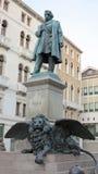 Statue of manin in venice, italy Stock Photo