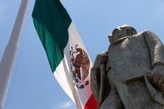 Mexican flag with Statue of Manuel Jose Othon stock photos