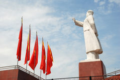 Statue of Mao zedong with red flags Stock Photos