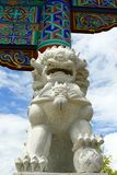 Statue of lion in chinese temple. Statue of marble lion in chinese temple royalty free stock images