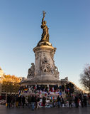 The statue of Marianne, Paris, France. Paris; France-December 04, 2015: The statue of Marianne(who symboloises the spirit of the French Republic)bedecked with Royalty Free Stock Images