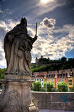 Statue and Marienberg Fortress in Wurzburg. St. Kilian statue on the Old Mainbrucke bridge and Marienberg Fortress, Wurzburg, Germany Royalty Free Stock Photo