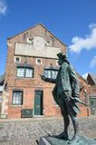 Statue of Maritime figure in front of Warehouse Royalty Free Stock Photography