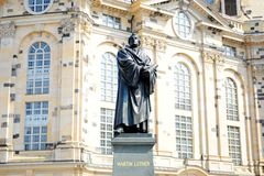 Statue of Martin Luther in front of the church Stock Photography
