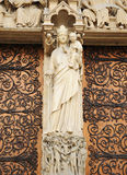 Statue of Mary on entry to Notre Dame de Paris Royalty Free Stock Image