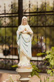 Statue of Mary praying in Stock Photo