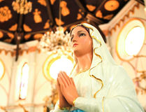 Statue of Mary praying in profile Stock Photo