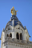Statue of Mary on top of Chapel de la Vierge at Basilica of Notre Dame de Fourviere in Lyon, France Stock Photo