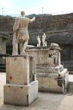 Statue and memorial altar in Roman Herculaneum, Italy Stock Images