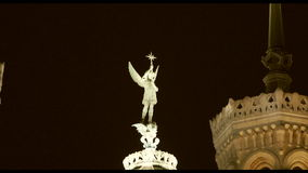 Statue of Michael (archangel) at top of Notre Dame de Fourviere in Lyon, France stock footage