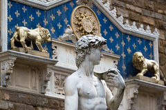 Statue of Michelangelo's David in front of the Palazzo Vecchio i Stock Photography