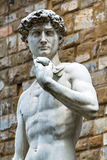 Statue of Michelangelo's David in front of the Palazzo Vecchio i Royalty Free Stock Images
