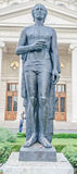 The statue of Mihai Eminescu, Romanian Athenaeum from Bucharest, Romania Royalty Free Stock Photo