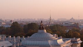 Statue of Minerva on the dome of the Academy of Arts. Aerial view on sunset. Neoclassicism historical building.
